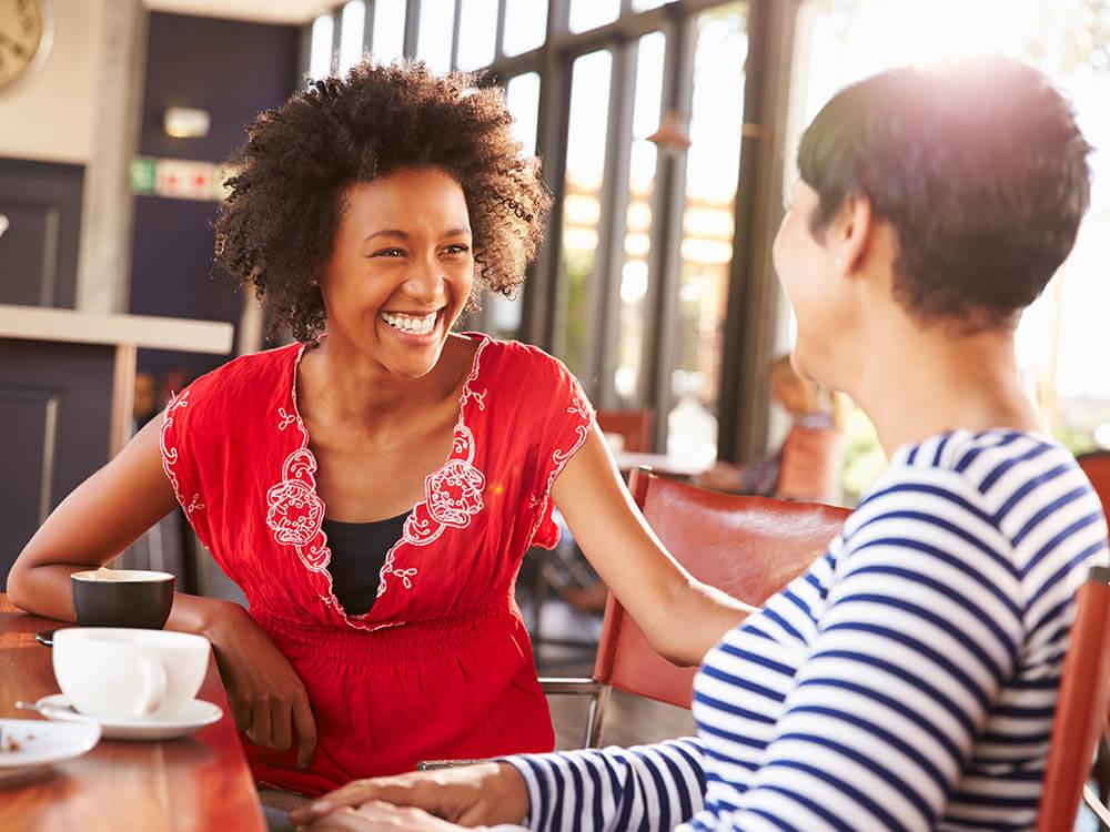 Two Women talking over coffee
